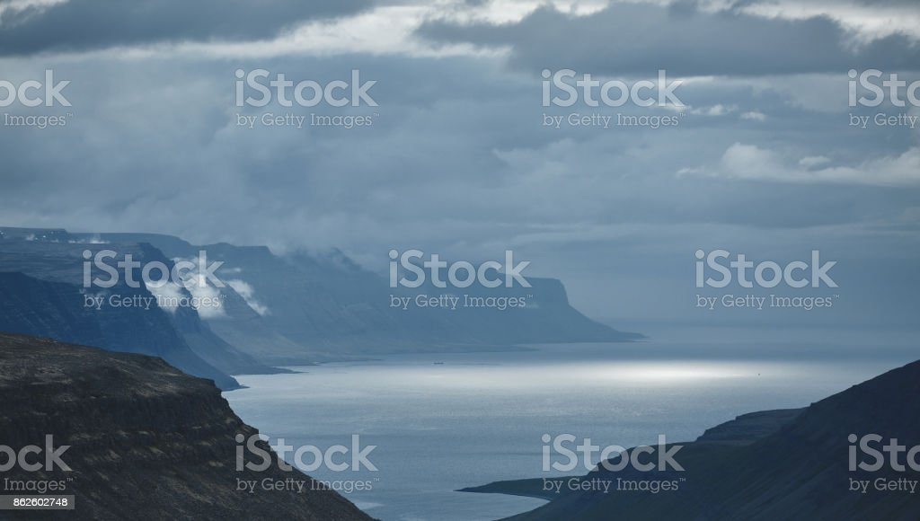 the austere Icelandic landscape with the mountains and the fjords in the background stock photo