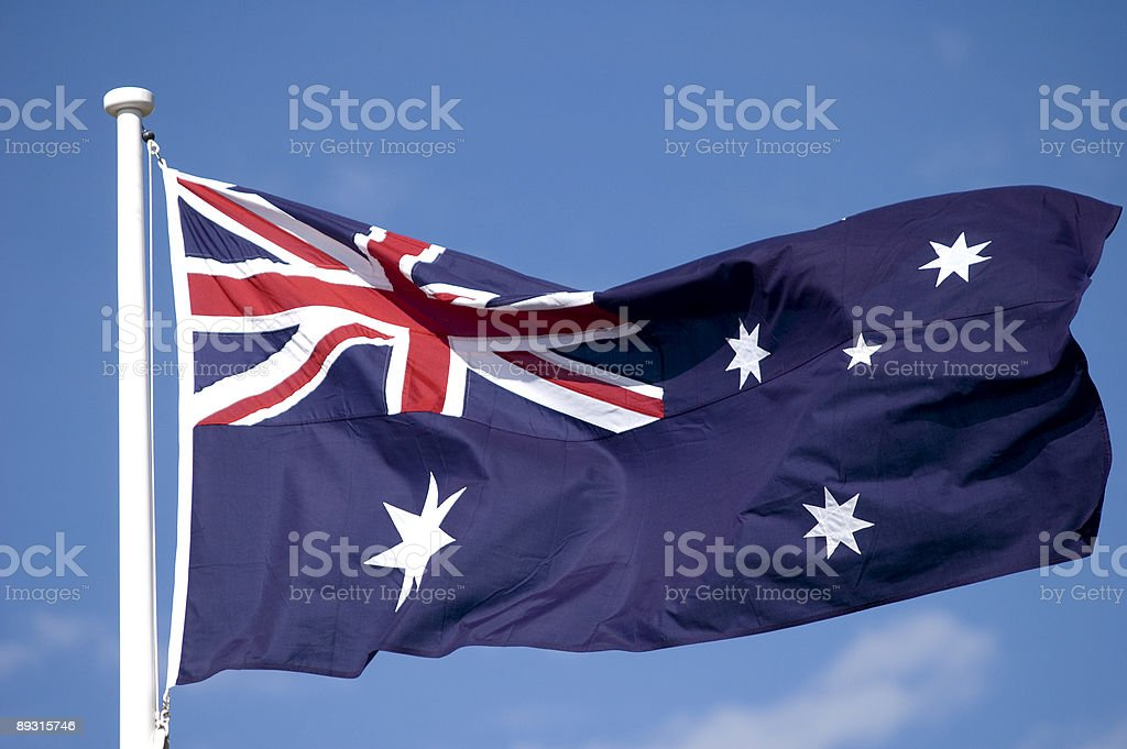 The Australian flag waving in the breeze stock photo