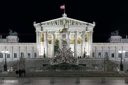 istock The Austrian Parliament Building and Pallas Athene Fountain in Vienna in night 1142546311