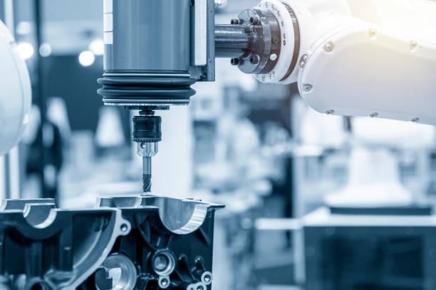 el fresado de piezas automotrices con herramienta de fresado plano fija el brazo robótico. - robótica fotografías e imágenes de stock