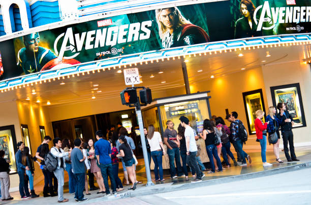 The Avengers Screening at Bruin Theater Los Angeles, California, USA - May 10, 2012: Young people, mostly students from the nearby UCLA, in line at the Bruin Theater entrance in Westwood Village to buy tickets for the evening screening of The Avengers. The 3D film has been produced by Marvel Studios and is distributed by Walt Disney Pictures. westwood neighborhood los angeles stock pictures, royalty-free photos & images