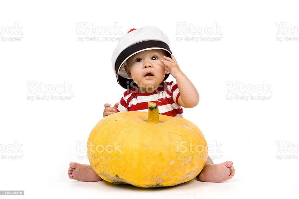 Le bébé et la citrouille royalty-free stock photo