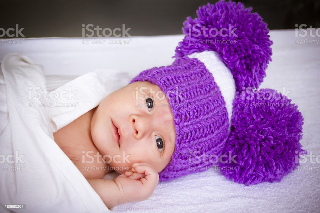 the baby in a violet knitted royalty-free stock photo
