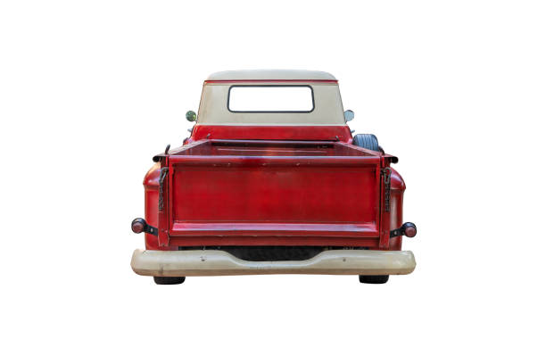 The back of a vintage red pickup truck,isolated on white background with clipping path stock photo