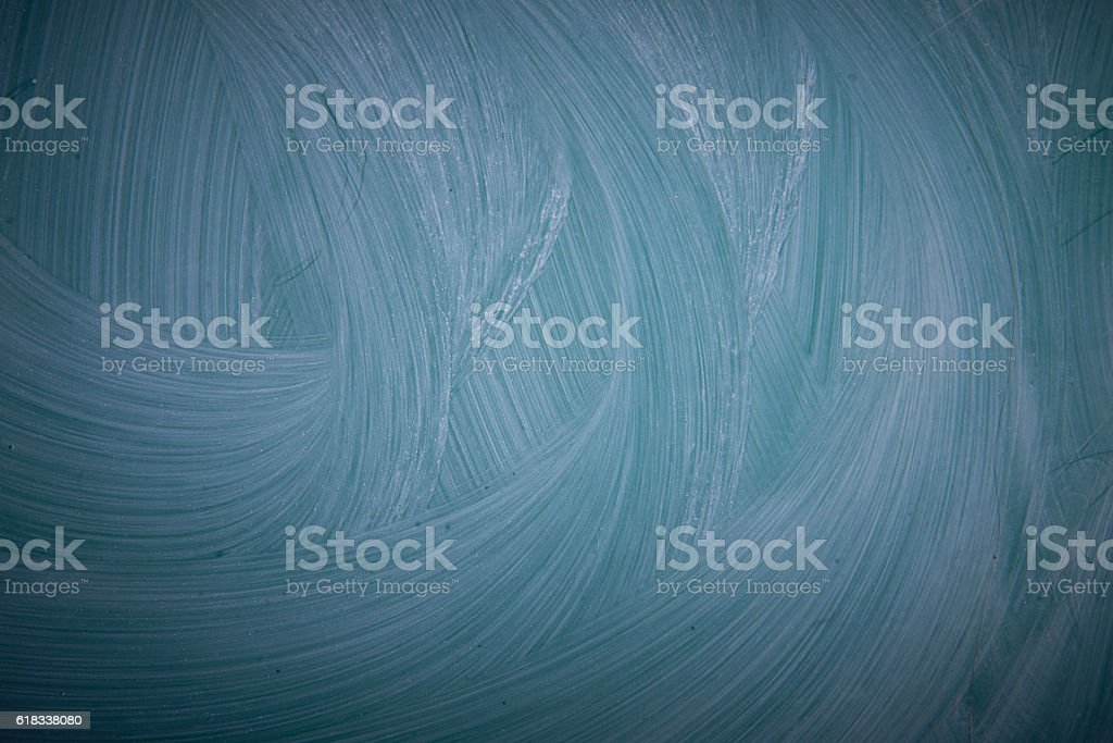 The background dark turquoise, blue with white patches. stock photo