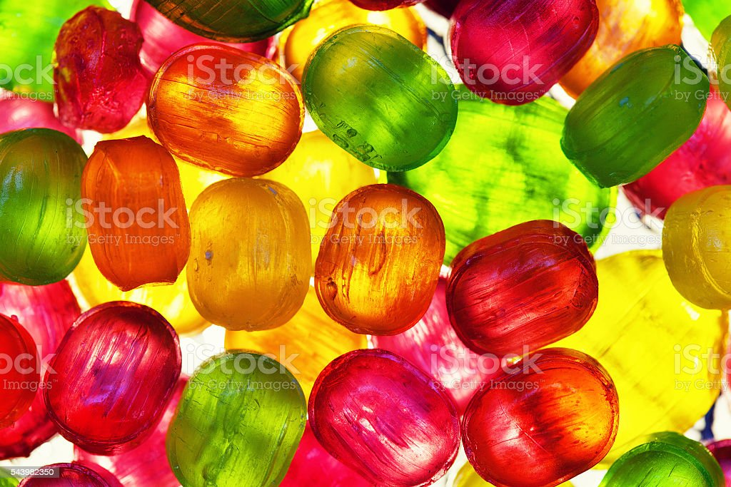 The background from scattering of multicolored candy stock photo
