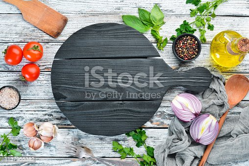 The background of cooking. Cutlery and kitchen board. Top view. Free space for your text. Rustic style.