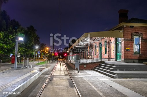 Melbourn, Australia - March 03: The Bacon Cove - Light Rail tram station at the Station Pier in Melbourn at night.