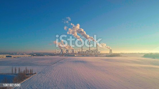 The bad ecology. The thermal power plant near by big city in the cold winter's day. Sukharevo district, Minsk, Belarus, Eastern Europe. Aerial drone photo