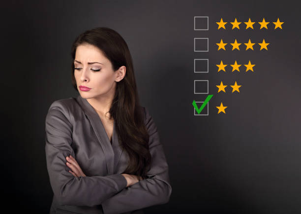 The bad, failure worst rating, evaluation, online review. One star. The time to make business better. Unhappy resentful business woman in suit with folded arms on grey background The bad, failure worst rating, evaluation, online review. One star. The time to make business better. Unhappy resentful business woman in suit with folded arms on grey background prettige verrassingen stock pictures, royalty-free photos & images