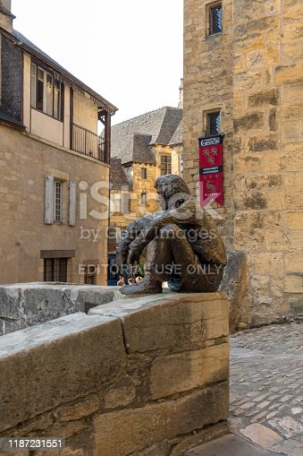Sarlat, France - September 2, 2018: The Badaud statue by Gerard Auliac at the Freedom Square in  Sarlat la Caneda in Dordogne Department, Aquitaine, France. The badaud is an important urban type from 18th and 19th-century French literature