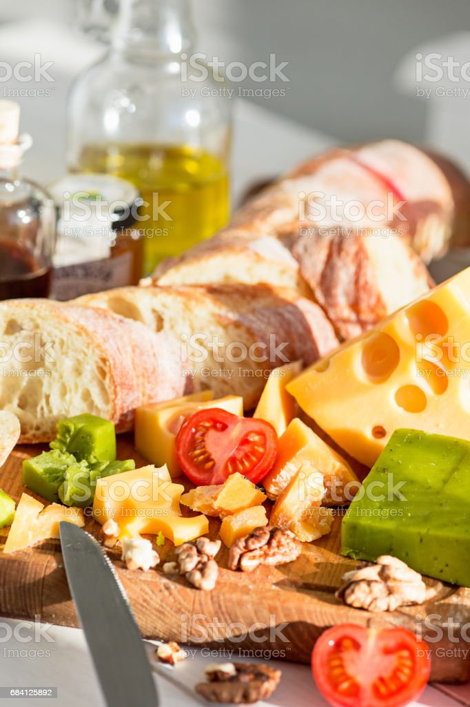 The baguette and cheese on wooden background zbiór zdjęć royalty-free