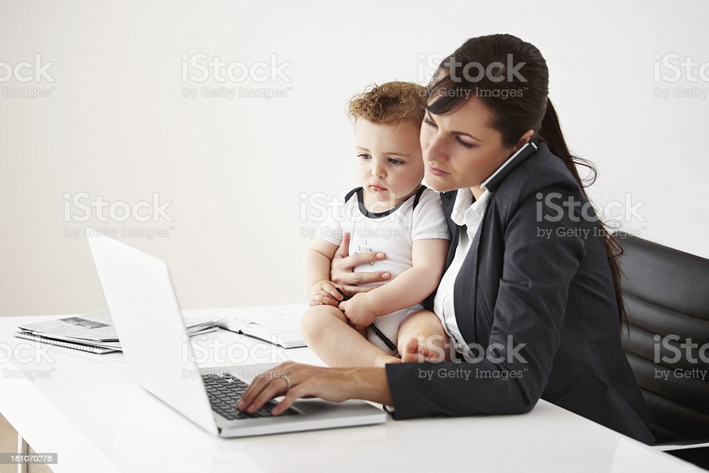The balancing act of a working mom stock photo