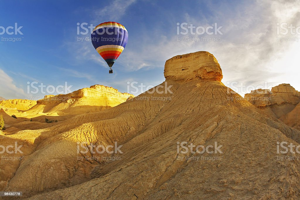 The  balloon above stone desert royalty-free stock photo