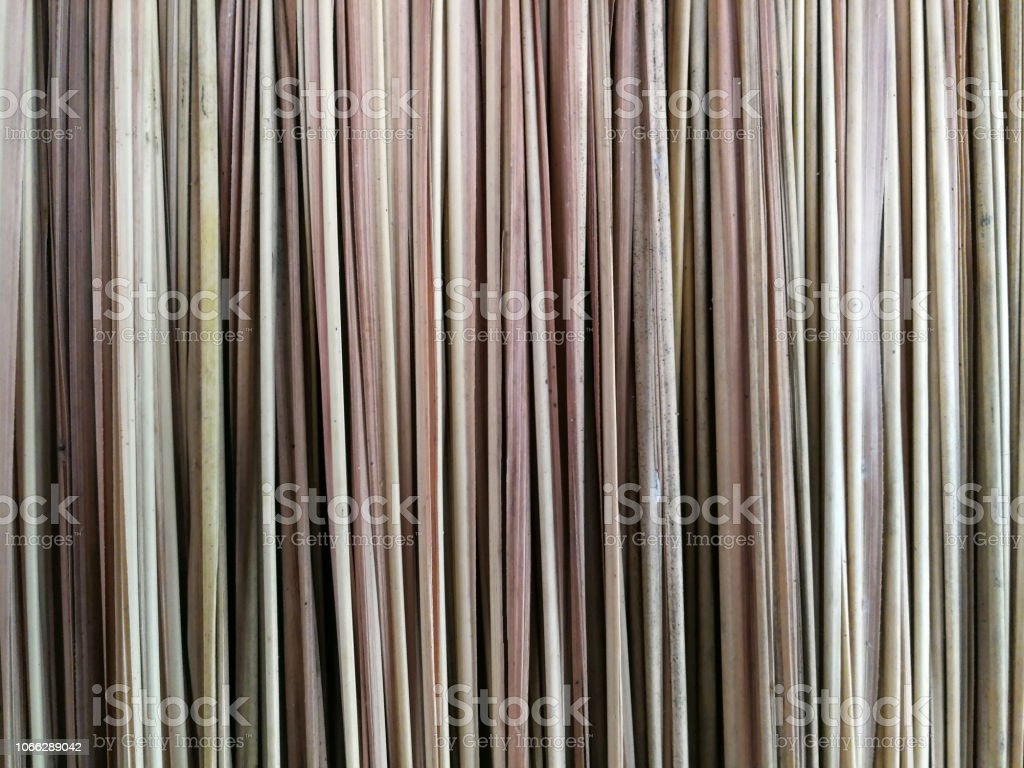 The bamboo leaves of brown thatched roof, used as background. Abstract natural roof background stock photo
