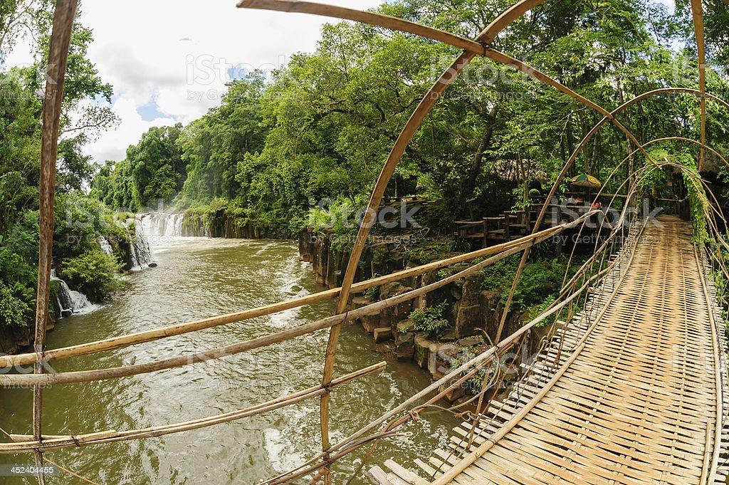 The bamboo rope bridge in Tad Pha Souam waterfall, Laos. stock photo