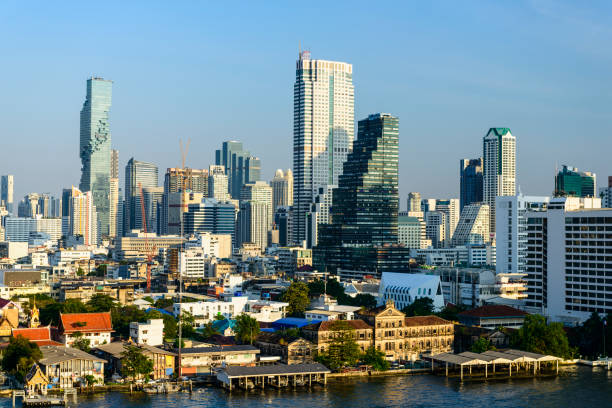 The Bangkok City Skyline and Chao Phraya River Near Sathon, Thailand stock photo