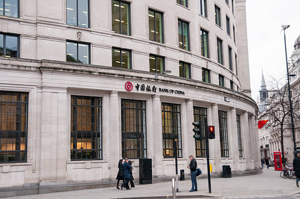 The Bank Of China London, United Kingdom - February 21, 2013: Pedestrians outside The Bank Of China in the financial district of the English capital city London bank of china stock pictures, royalty-free photos & images