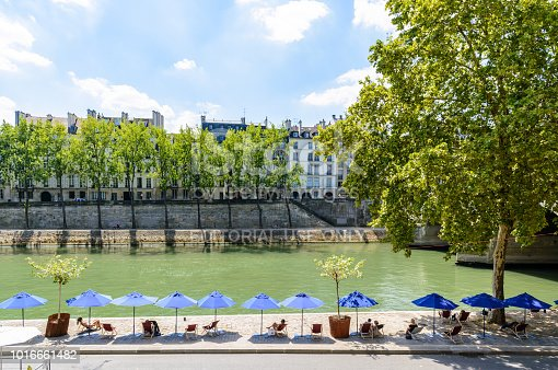 Paris, France - August 2, 2018: Every July and August since 2002 the banks of the Seine are converted into seaside walk with deck chairs and parasols during Paris-Plages summer event.