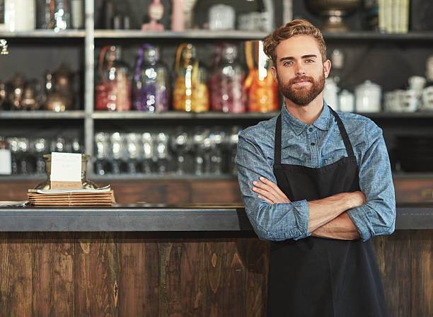 the barista who brews it best - barista stock photos and pictures