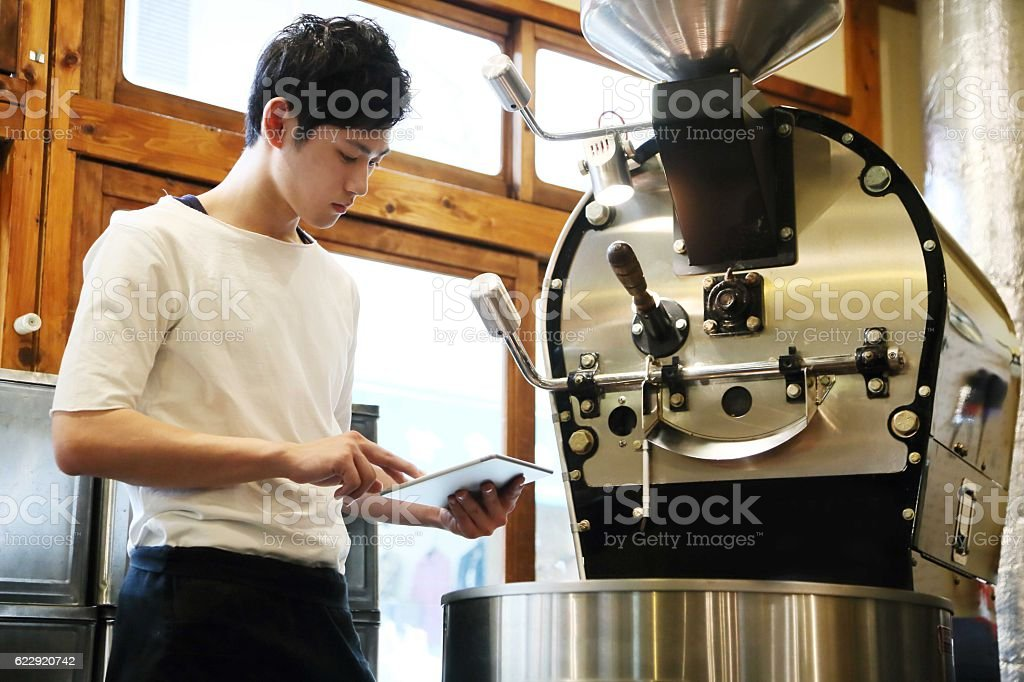 The barista who inputs data into a tablet stock photo