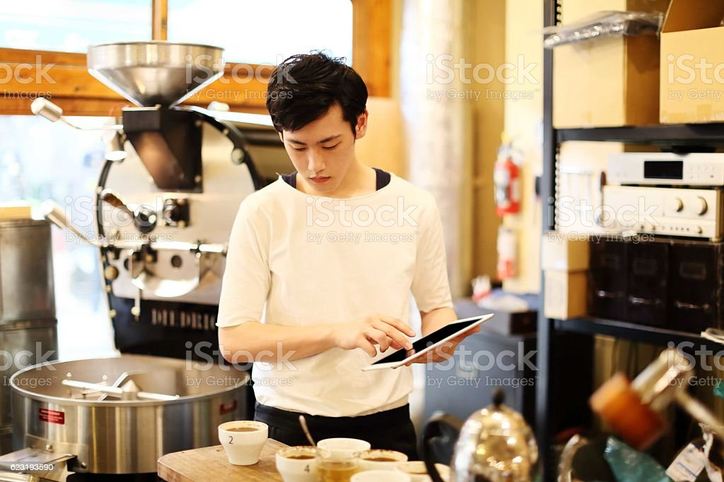 The barista who inputs sampling data stock photo