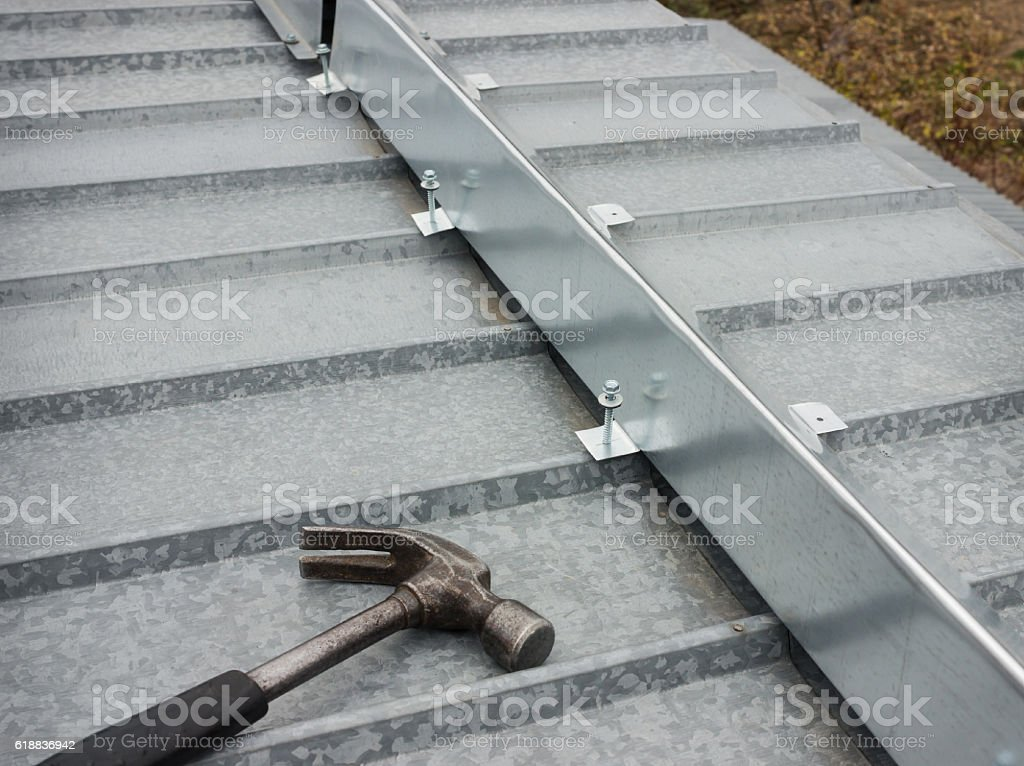 The barrier for snow guard on the edge of roof stock photo