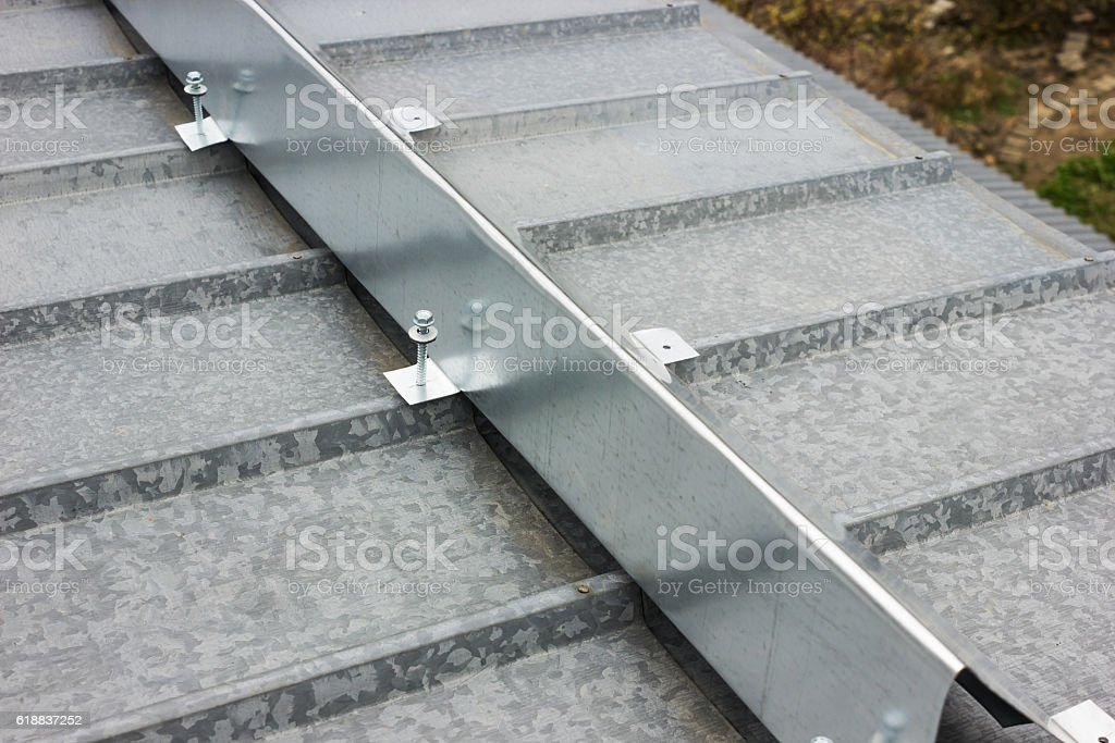 The barrier for snow retention on thel roof stock photo