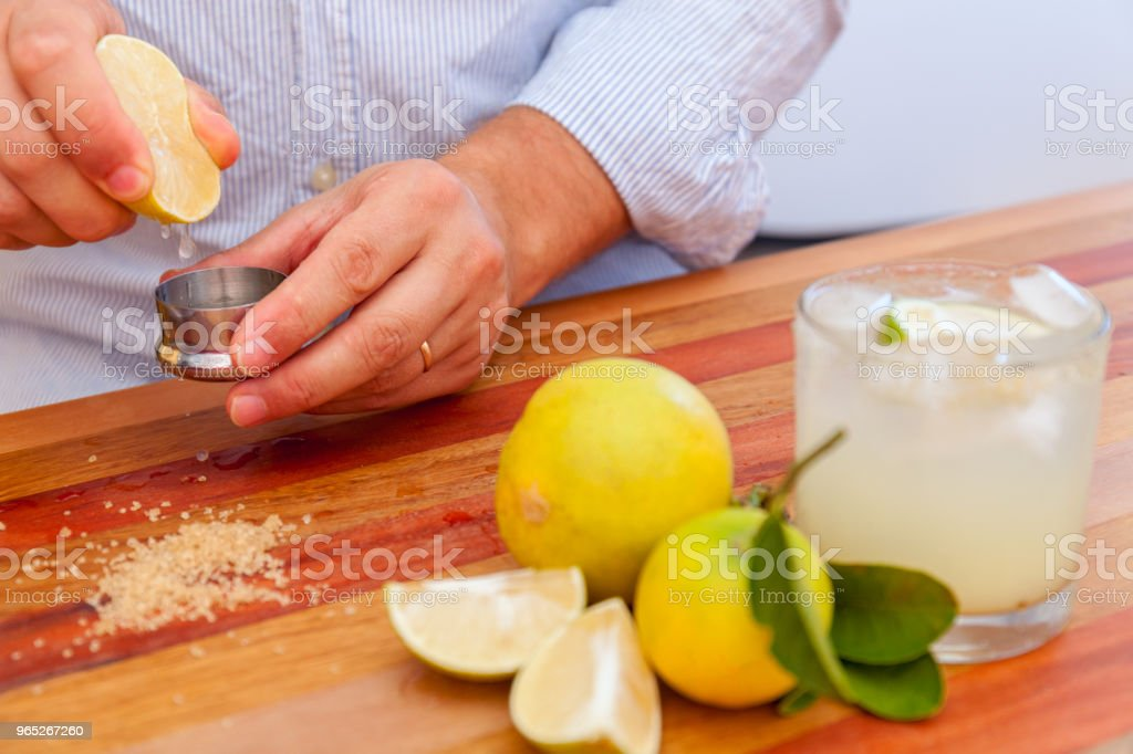 The bartender make margaritas of Mexican lime. alcoholic cocktail served a measuring glass zbiór zdjęć royalty-free