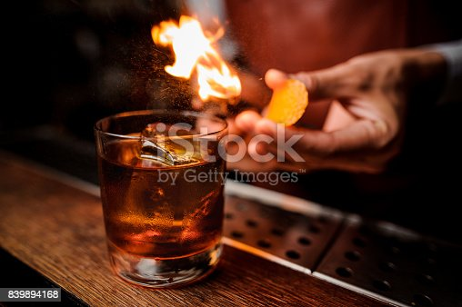 istock The bartender makes flame above cocktail close up 839894168