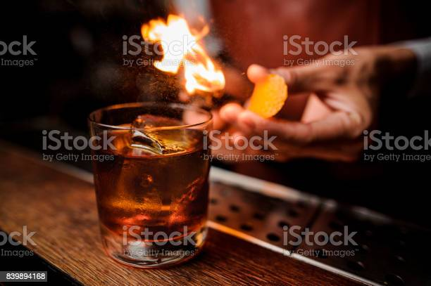 The bartender makes flame above cocktail close up picture id839894168?b=1&k=6&m=839894168&s=612x612&h=tft4tc9fdhix9jcnnpi66ow6v9c0hcwnhobieexu p0=