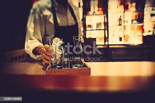 A bartender preparing a drink in a bar in berlin
