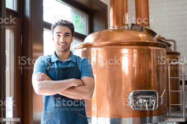 The Bartender Standing With Crossed Arms In Microbrewery Stock Photo - Download Image Now