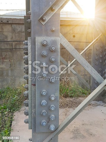 istock The base construction of the high voltage tower have bolts and nuts for Assemble each piece together. 930848190