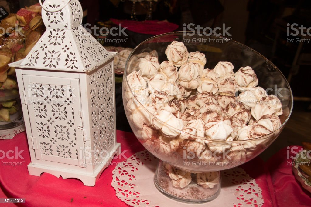The basket of vanilla meringues on bakery counter stock photo