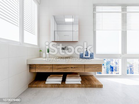The bathroom in the bathroom, the white cabinet with white clean towels, green plants on the counter, and glass windows next to it