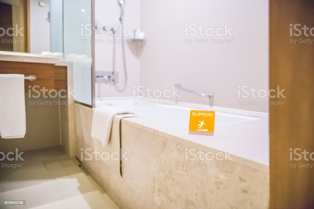 The bathroom of the hotel and caution sign stock photo