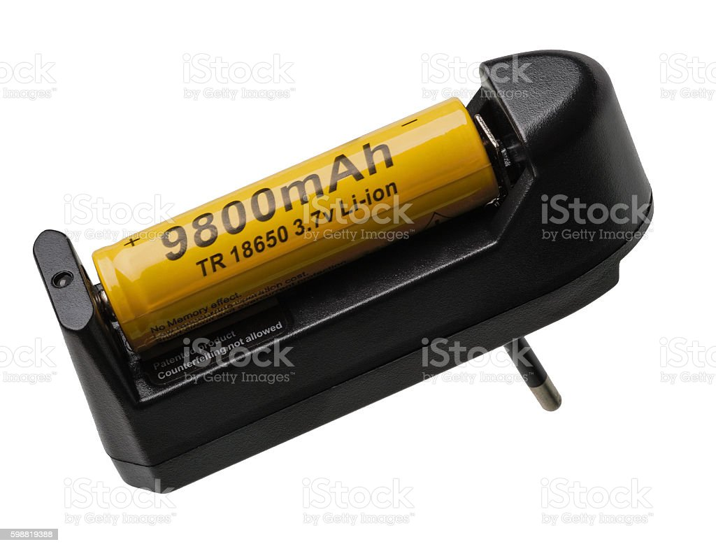 The battery is charged in the battery charger stock photo