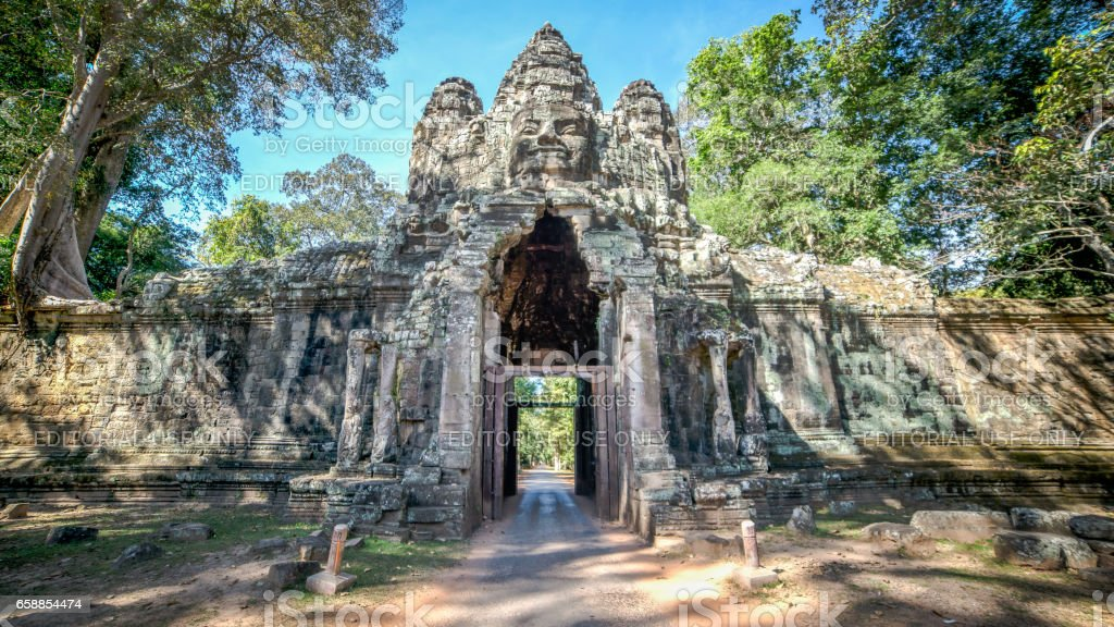 The Bayon gate of Angkor Thom the ancient Khmer empire in Siem Reap, Cambodia. stock photo