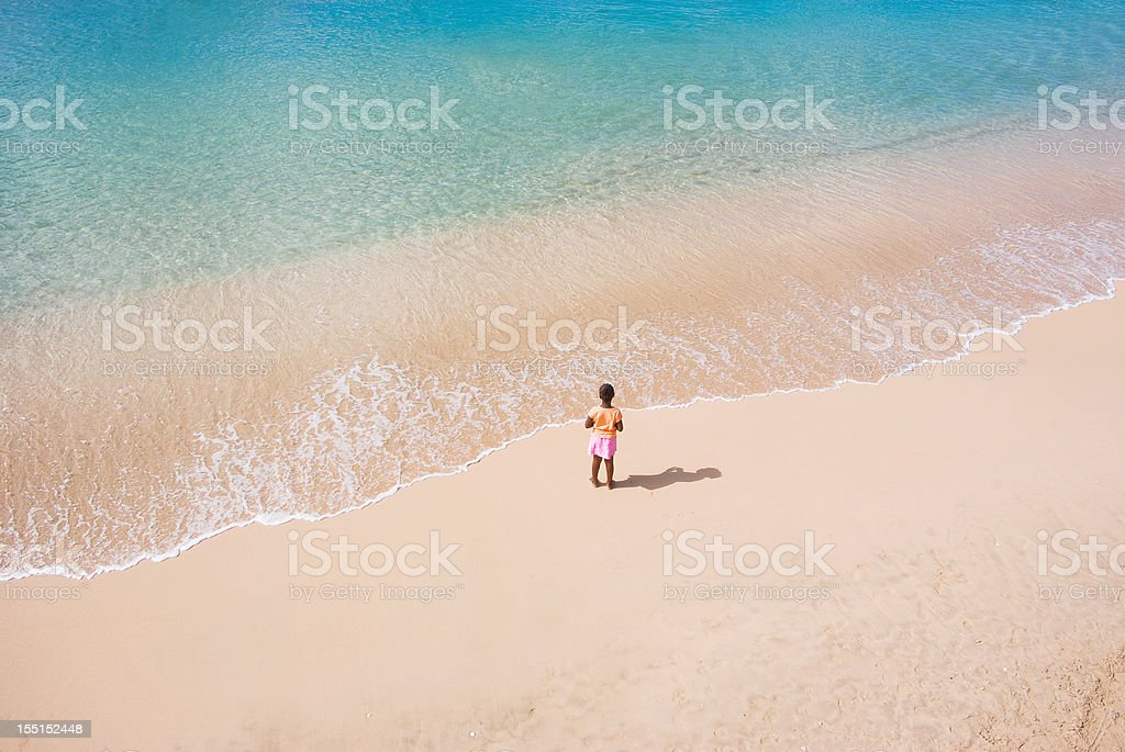 the beach and a little girl stock photo