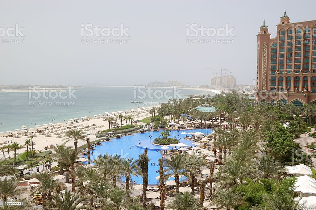 The beach and swimming pool at luxury hotel, Dubai, UAE stock photo
