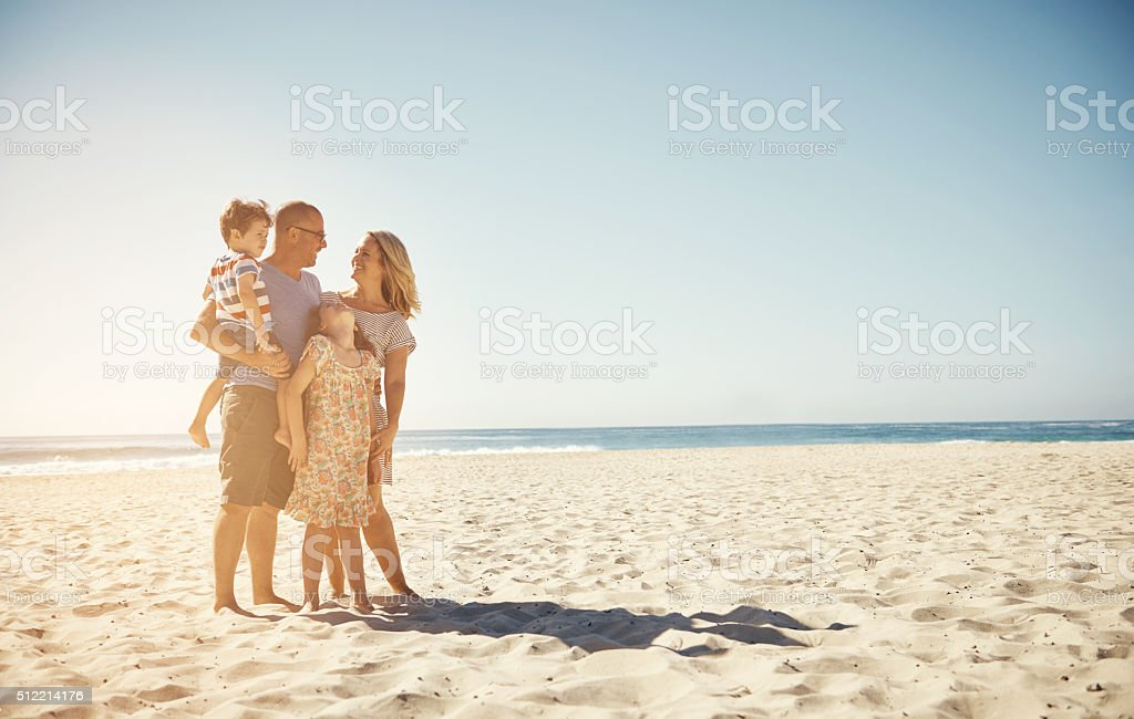 The beach is our happy place stock photo