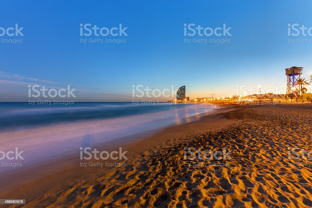 The beach of Barcelona at sunset stock photo