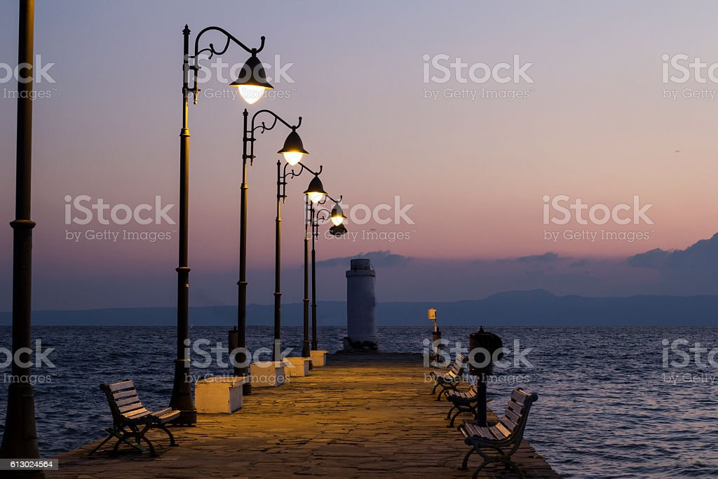 The Beach pier with lamps at sunrise stock photo
