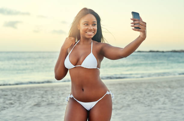 the beach selfie - curvy voluptuous women stock photos and pictures