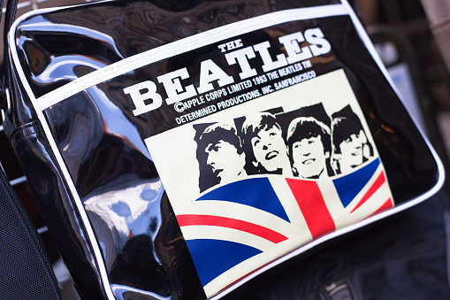 London, England - May 2, 2011: a bag with The Beatles sign and Union Jack is on sale in a shop located in Camden Town in London.