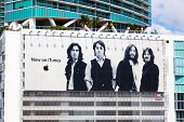 Miami, Florida, USA - March 19, 2011: a large Apple billboard hanging on a building in Downtown Miami shows that The Beatles music band is now on sale on iTunes.