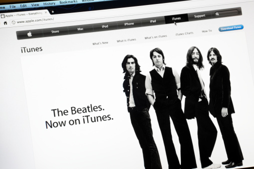 Rome, Italy - May 12, 2011: Screen shot of the Apple Computers website, with the music band of the Beatles. The songs of the music band are now on sale on iTunes. iTunes is a proprietary digital media player application, used for playing and organizing digital music and video files.