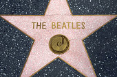 'Los Angeles, California, USA - March 25th 2011: The Beatles star at the Hollywood Walk of Fame. The Beatles are one of the most visited landmarks at the Walk of Fame.'