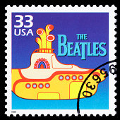 Sacramento, California, USA - March 19, 2011: A 1999 USA postage stamp with an illustration of the Yellow Submarine, the 1968 animated movie featuring songs by The Beatles. The Beatles' logo is also shown, which is a registered trademark of Apple Corps Limited; Yellow Submarine is a registered trademark of Subafilms Limited.